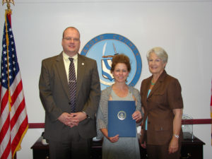 Harford County Office of Information & Communications Technology employee Cheryl Landreth accepts the county's Employee of the Month award for June from ICT Director Ted Pibil and Director of Administration Mary Chance.