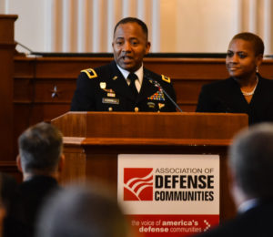Maj. Gen. Robert S. Ferrell, Senior Commander of Aberdeen Proving Ground, Md., expresses his appreciation to Association of Defense Communities after accepting the organization's Military Leadership Award during a breakfast on Capitol Hill June 13, 2013, as his wife, Monique Ferrell stands by his side.