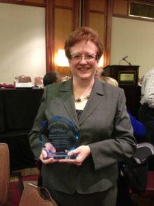 Tami Zavislan accepts Pioneer Award. Photo courtesy of the Community Foundation of Harford County