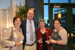 L-R: Debbie Cassilly, Bob Cassilly, Cecilia Hawkins and Michele Hawkins celebrate the Harford Land Trust at the third annual Harvest Moon Dinner and Auction.