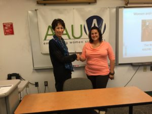 AAUW President Bernadette Low presenting a scholarship to Kristin Bauer